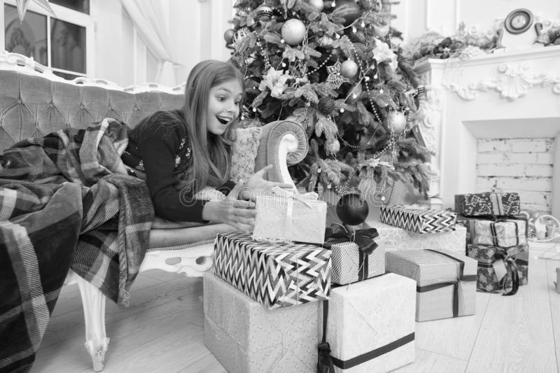 Happy new year. Winter. Opening her Christmas present. Christmas tree and presents. xmas online shopping. Family holiday. The morning before Xmas. Little girl royalty free stock photo