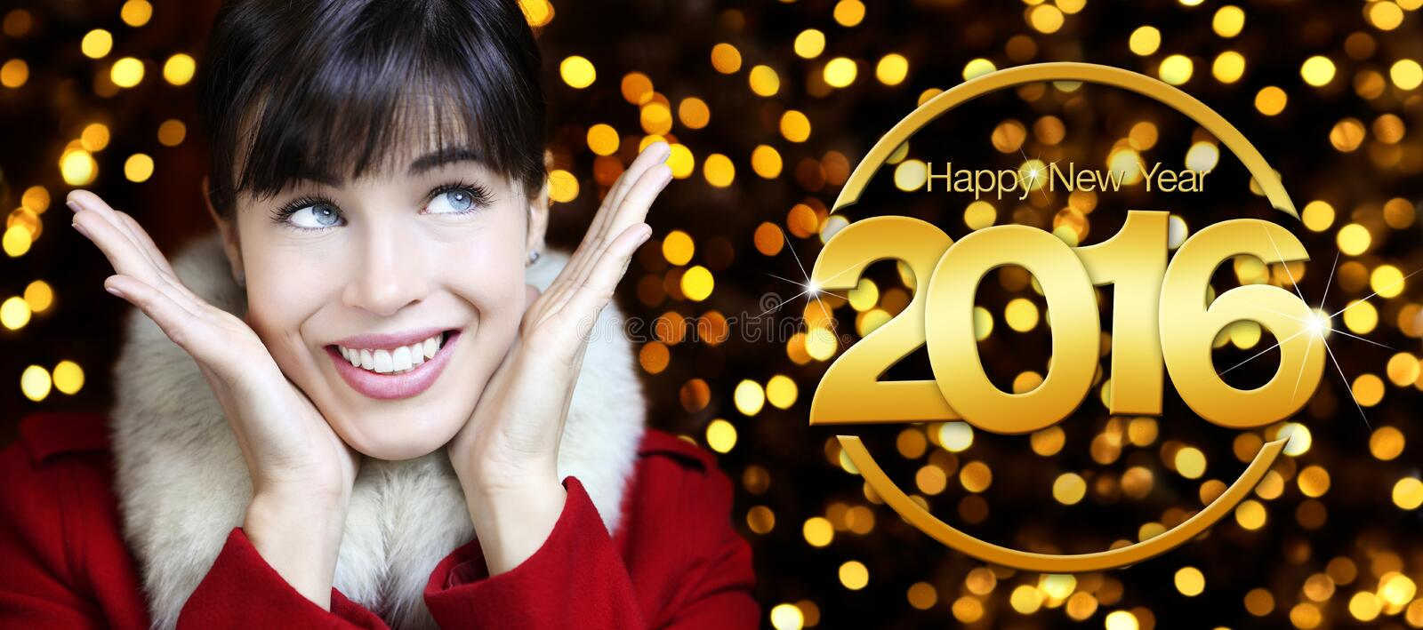 Happy new year 2016, woman looks up on lights background. Happy new year 2016 golden text, woman looks up on lights glitter background stock image