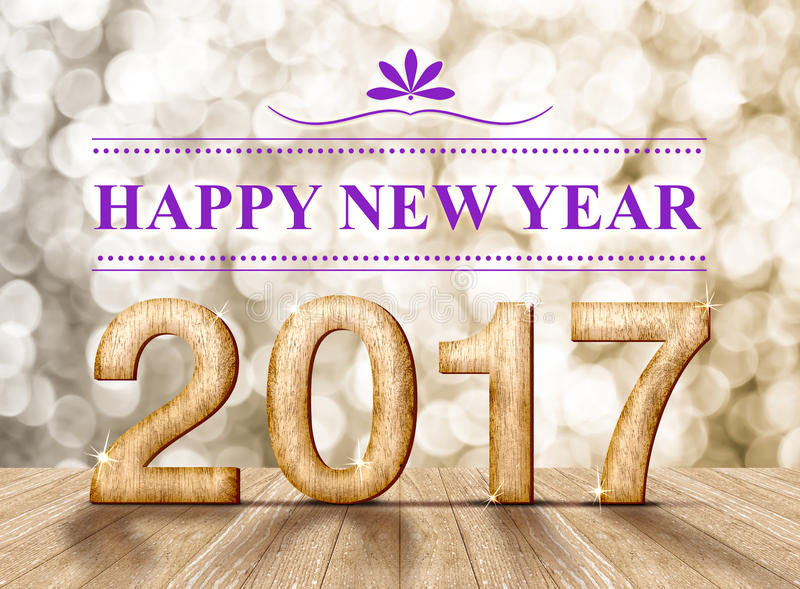 Happy new year 2017 wood number in perspective room with sparkling gold bokeh light and wooden plank floor.  royalty free stock photos