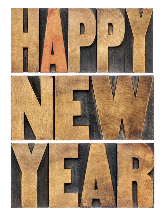 Happy New Year in wood type. Happy New Year greetings or wishes - isolated text in vintage letterpress wood type printing blocks royalty free stock photo