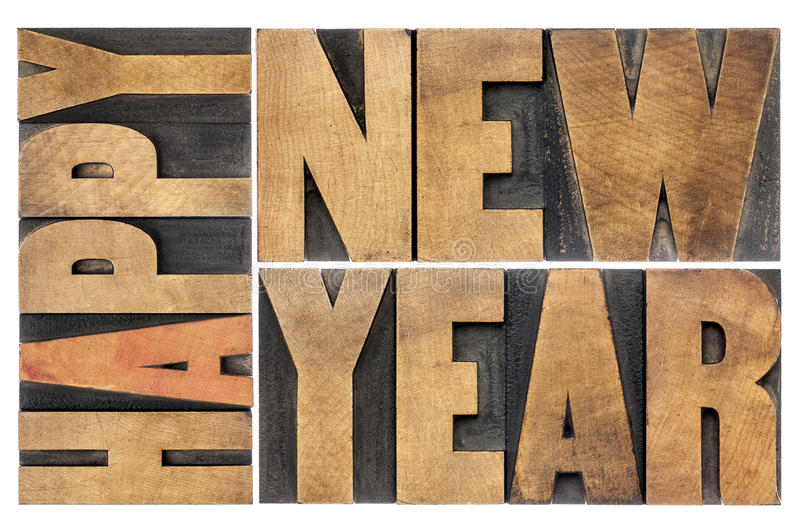 Happy new year in wood type stock images