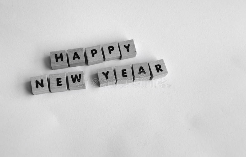 Happy new year. Wooden blocks on white background spelling HAPPY NEW YEAR royalty free stock image