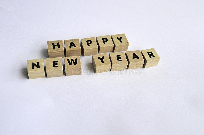 Happy new year. Wooden blocks on white background spelling HAPPY NEW YEAR stock photo