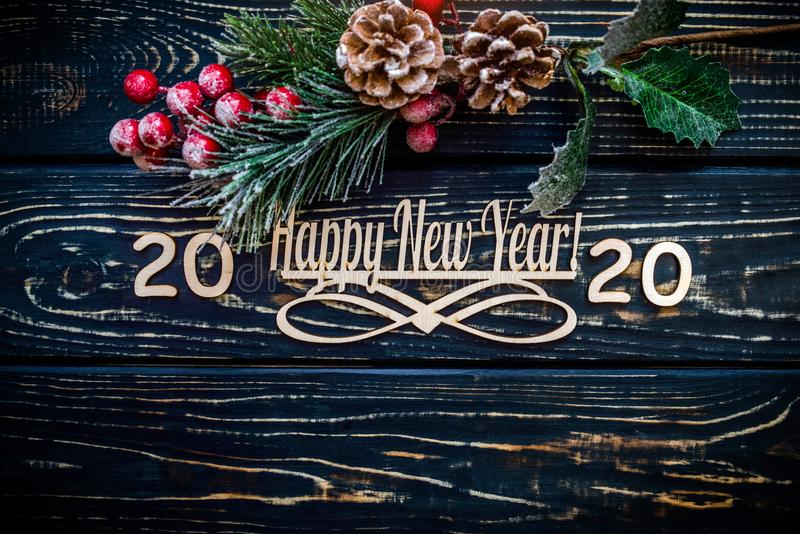 Happy new year 2020. On wooden brown background stock photo