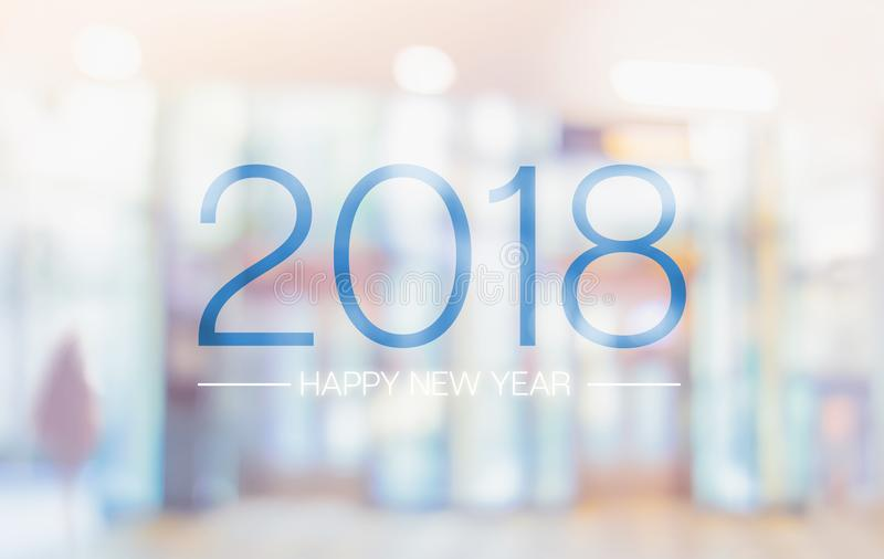 Happy new year 2018 word on blur pale color convention hall office building bokeh background. royalty free stock photo