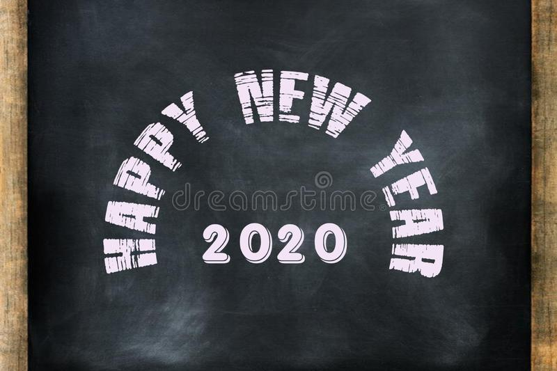 happy new year 2020 word displayed on chalkboard concept stock photo