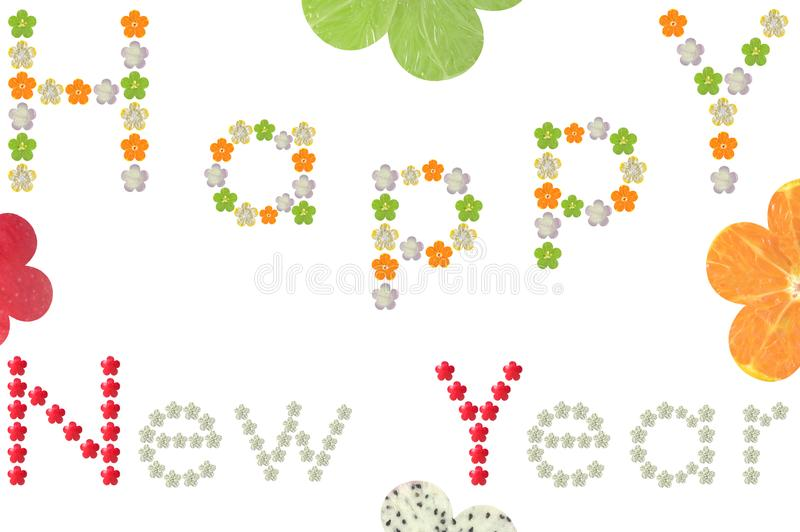 Happy New Year word from flower shaped fruit and vegetable. On white background stock photos