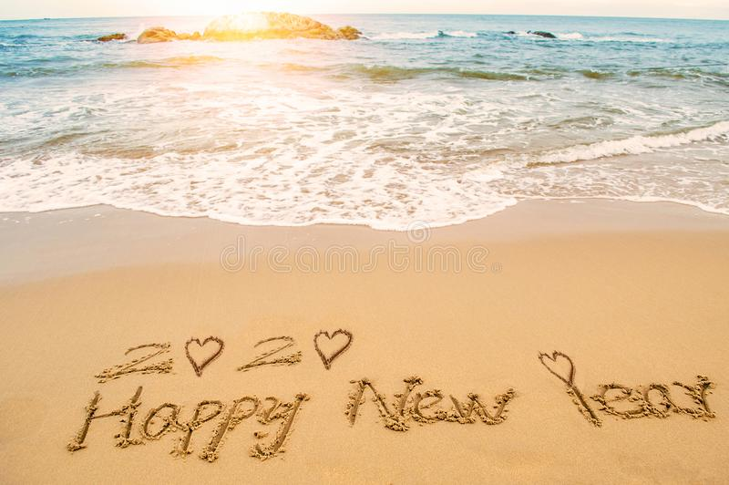 Happy new year 2020. Word 2020 happy new year and love heart write on beach stock images