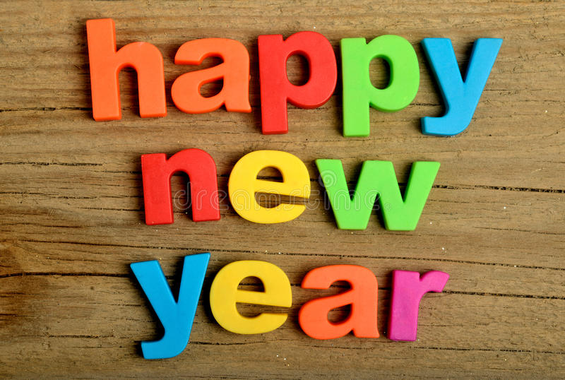 Happy New Year word. On wooden table royalty free stock photos
