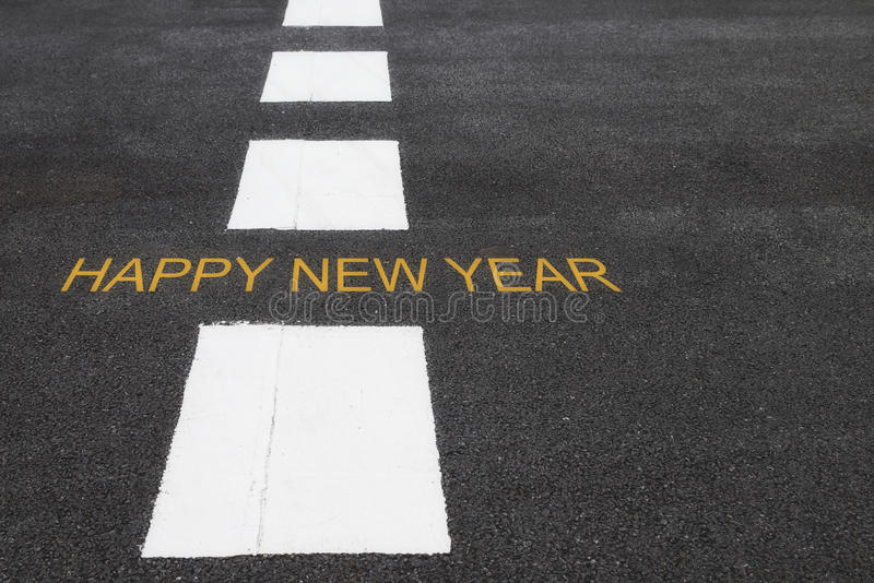 Happy new year words on asphalt road. Surface with marking lines, happy new year concept stock images