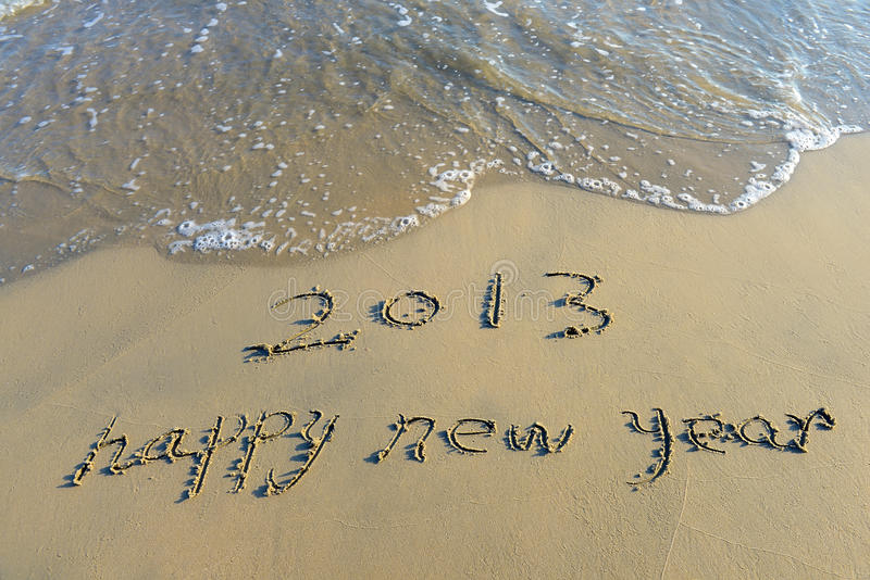 Happy New Year Written In Beach Royalty Free Stock Image