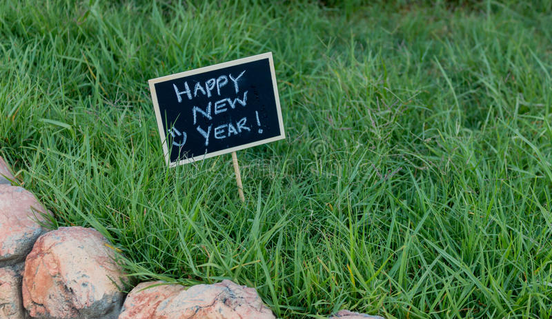 Happy New Year written on black chalkboard royalty free stock images