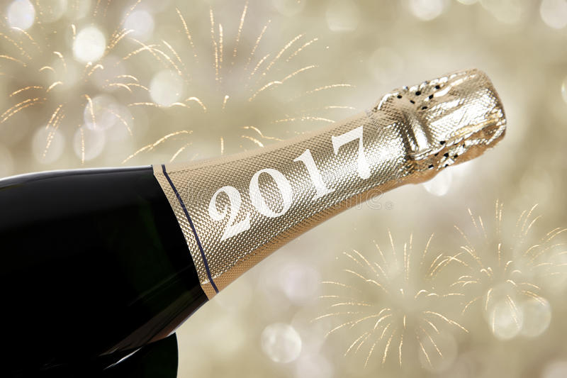 Happy new year 2017. Written on a bottle stock images