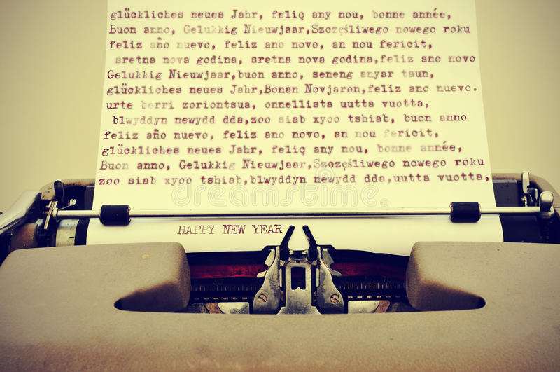 Happy new year. Written in different languages with an old typewriter, with a retro effect stock images