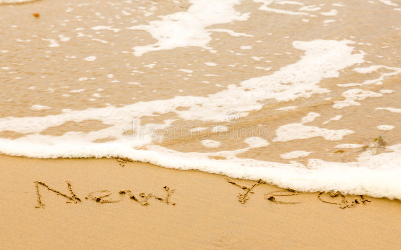 Happy New Year Written In Sand On Beach Stock Image