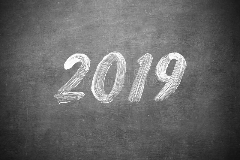 Happy New Year 2019 Writting on classroom blackboard. Happy New Year 2019 Hand Writting on classroom blackboard stock photography