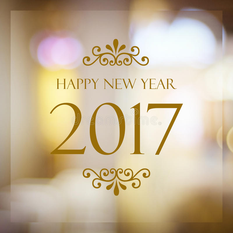 Happy New Year 2017 year on abstract blur festive bokeh background stock photos