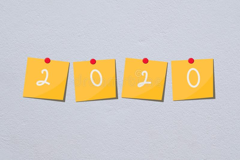 2020 happy new year yellow paper note on white wall stock photos