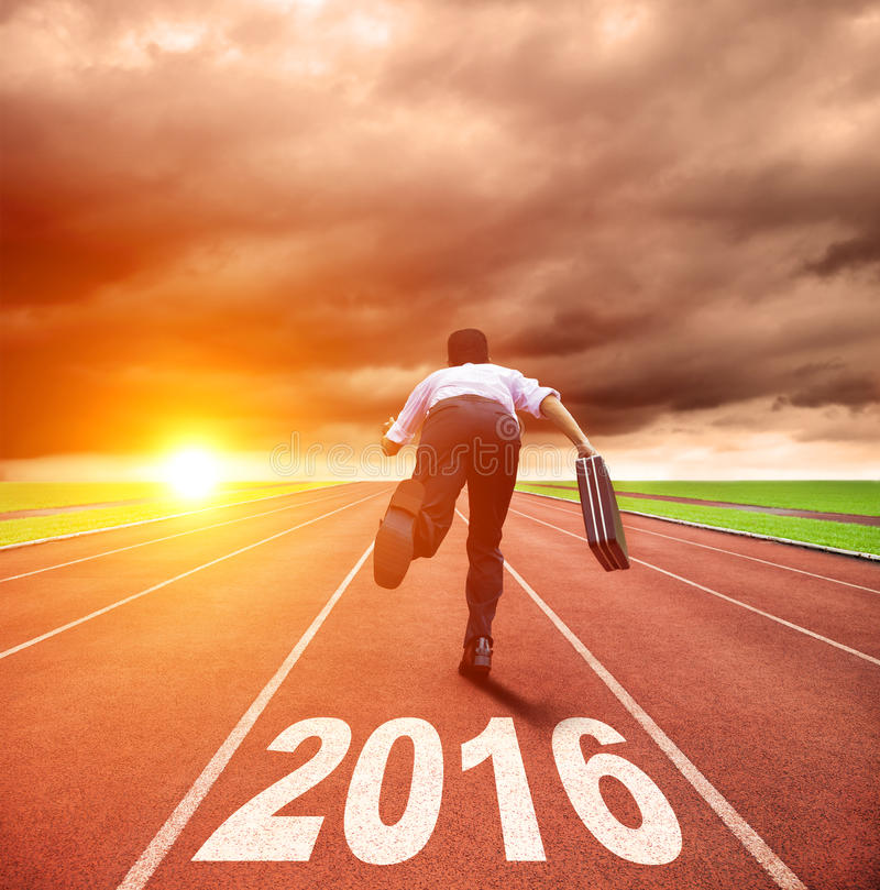 Happy new year 2016. young man running stock images