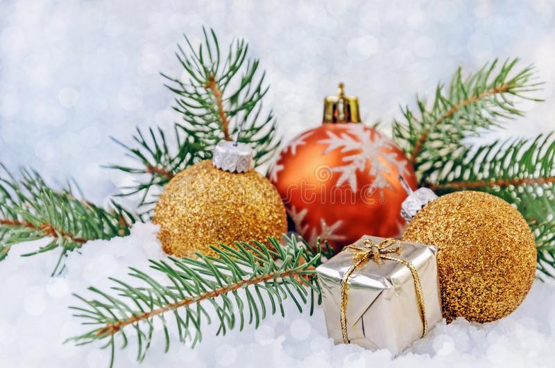 Happy New Years background with christmas balls, small box with present and fir branches. Festive Happy New Years background. Christmas balls, a small box with royalty free stock photos