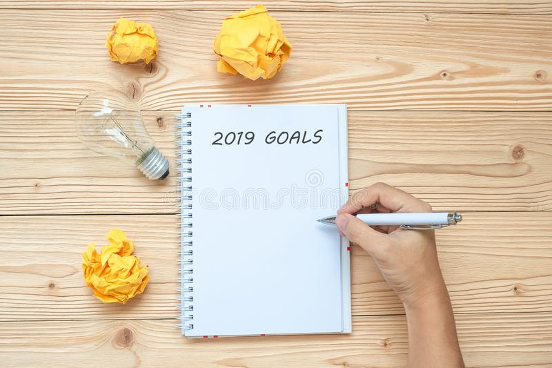 2019 Happy New years with Businessman writing with lightbulb and crumbled paper on table. New Start, Idea, Creative, Innovation, royalty free stock photography