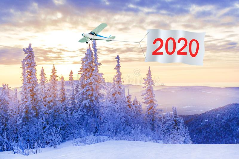 Happy New Years 2020 concept.  Airplane with message number 2020 royalty free stock photos
