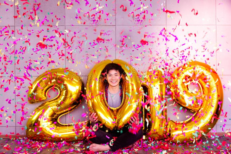Happy New Years 2019 concept. Charming handsome man gets celebrating and has fun on New Years 2019. Attractive handsome asian guy stock photo