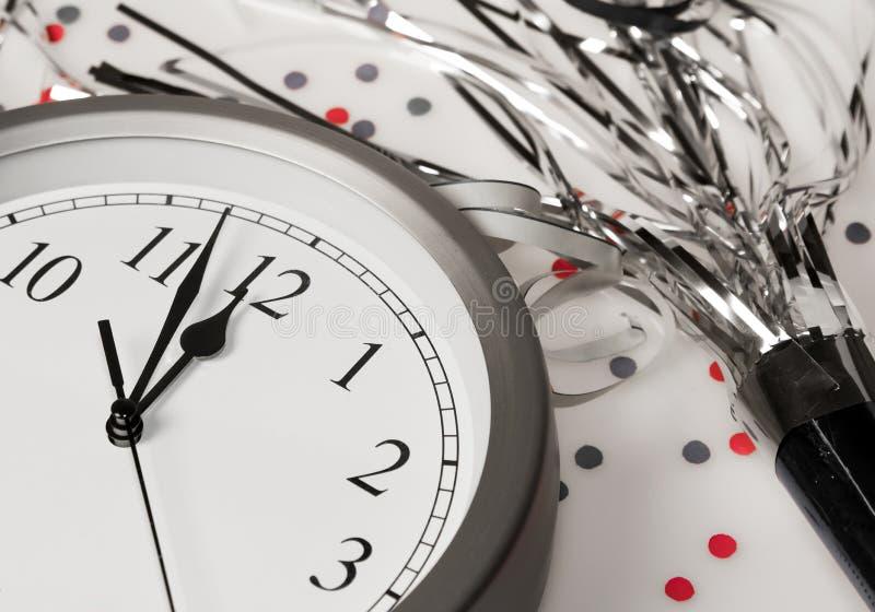 Happy New Years Eve Celebration Countdown Clock. New Years Eve clock is ticking down to annual midnight celebration stock image