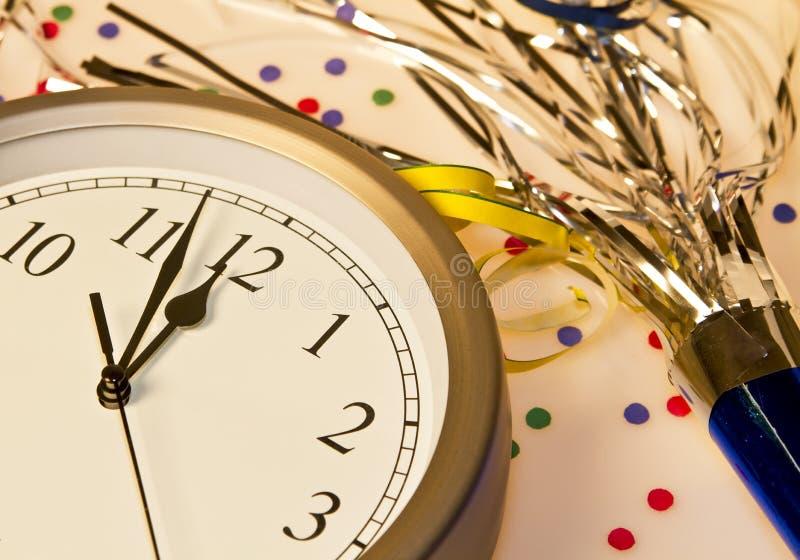 Happy New Years Eve Celebration Countdown Clock. New Years Eve clock is ticking down to annual midnight celebration royalty free stock image