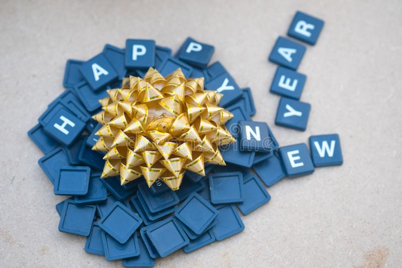 Happy New years with gold bow gift box. Concept background for happy new year royalty free stock photo