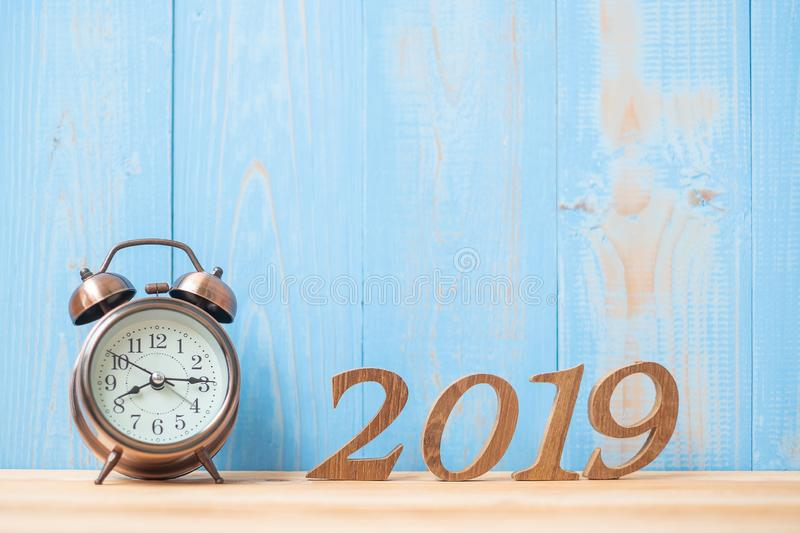 2019 Happy New years with retro alarm clock and wooden number on table and copy space. royalty free stock photography