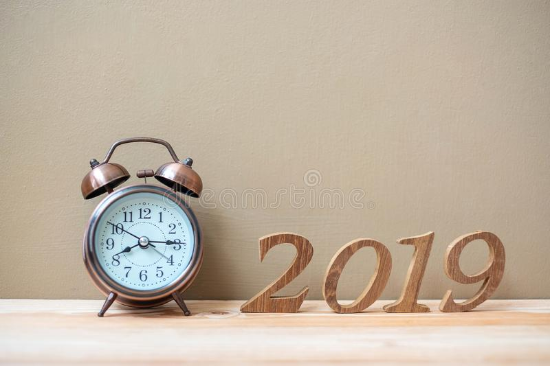 2019 Happy New years with retro alarm clock and wooden number on table and copy space. New Start, Resolution, Goals and Mission royalty free stock photo