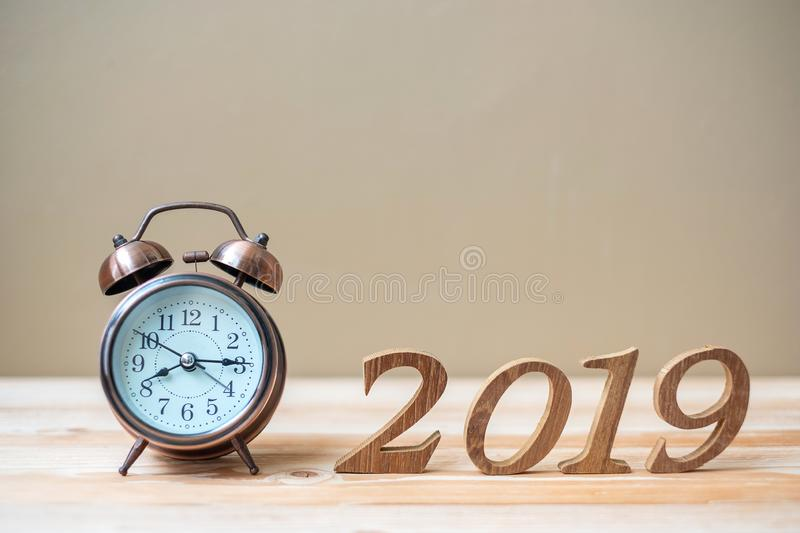 2019 Happy New years with retro alarm clock and wooden number on table and copy space. New Start, Resolution, Goals and Mission royalty free stock photos