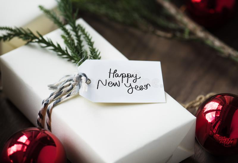 Happy New Years tag on a gift box royalty free stock photography