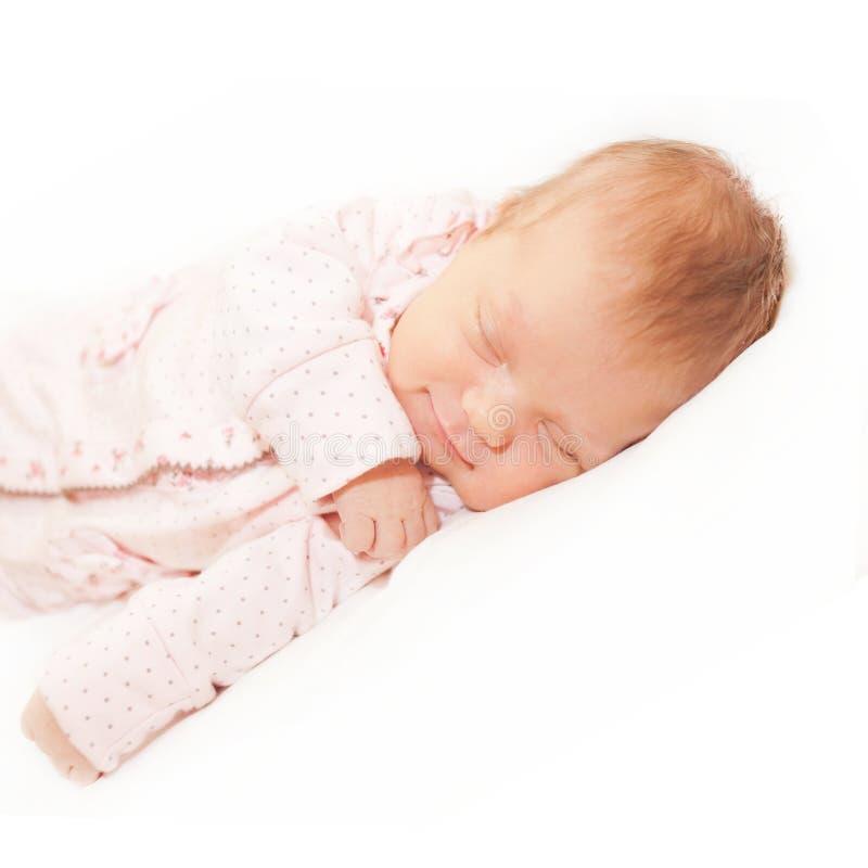 Happy newborn baby sleeping. royalty free stock images
