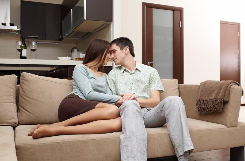 этого пара ласкается сидя на диване друг другу ничего