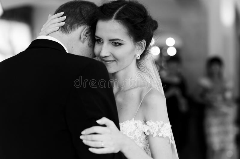 Happy newlywed bride and groom dancing at wedding reception closeup b&w royalty free stock images