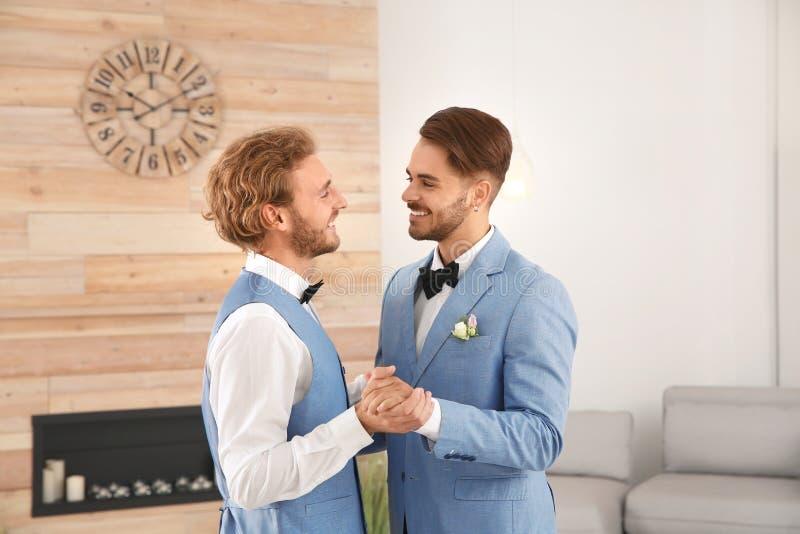 Happy newlywed gay couple dancing royalty free stock photos