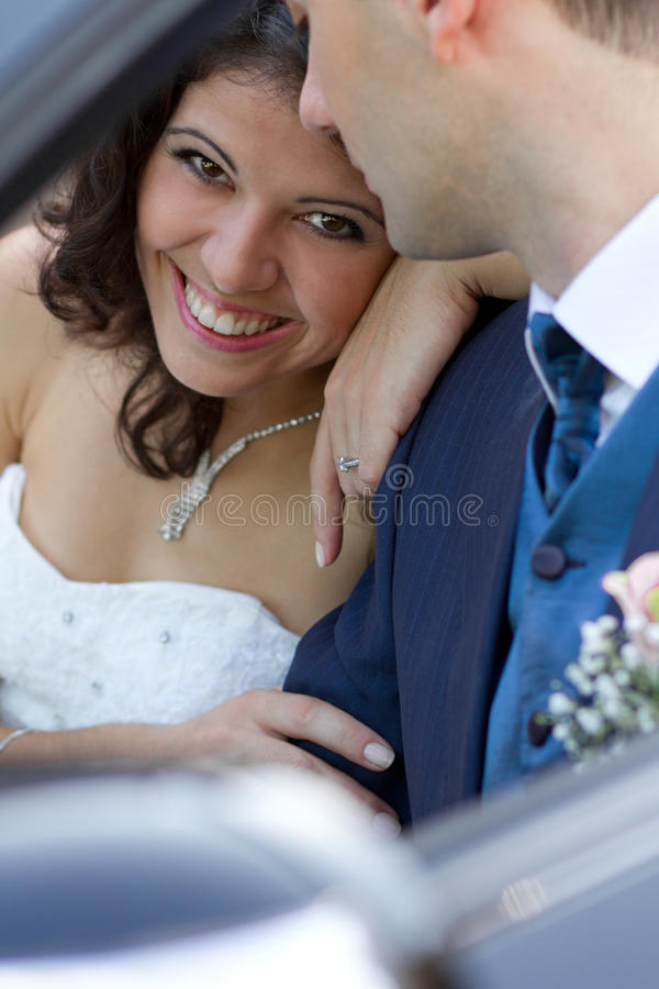 Happy newlyweds in cabrio stock photos