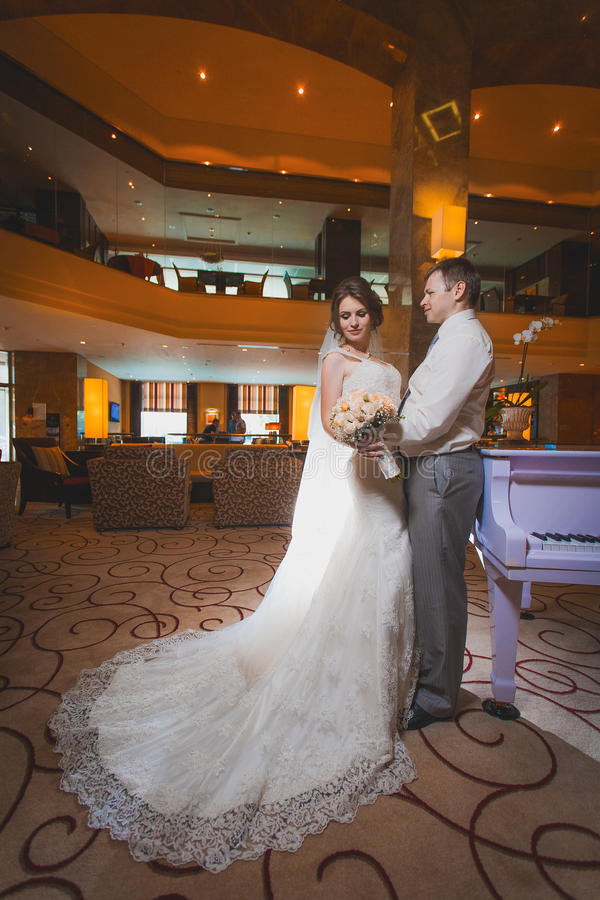 Download Happy Newlyweds In The Modern Hall Stock Photo - Image: 33125762