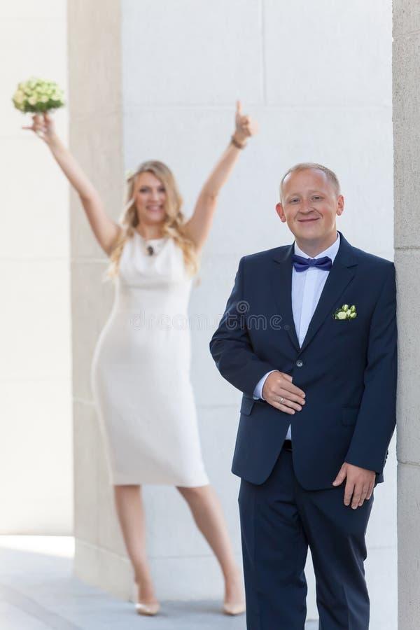 Happy newlyweds near bride and groom wedding. Happy newlyweds near bride and groom stock photos