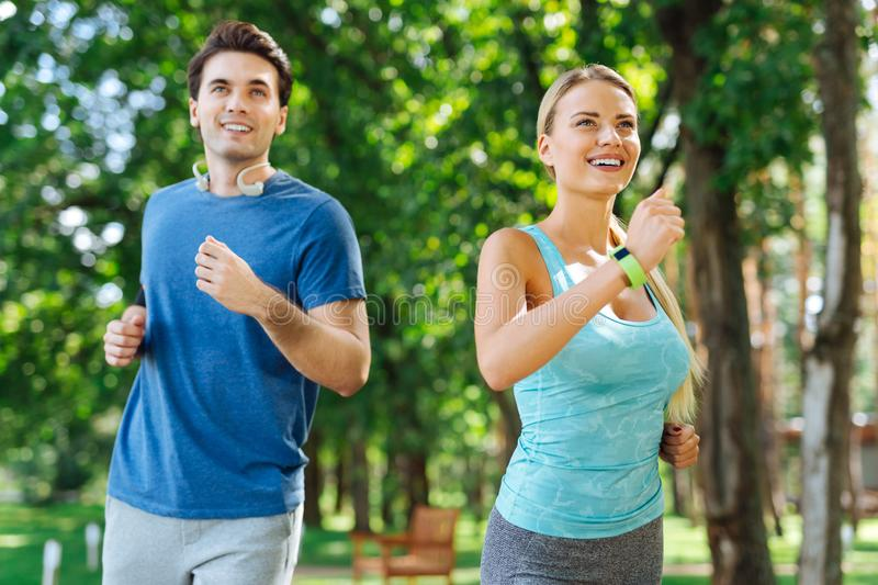 Happy nice active people enjoying running together stock photo