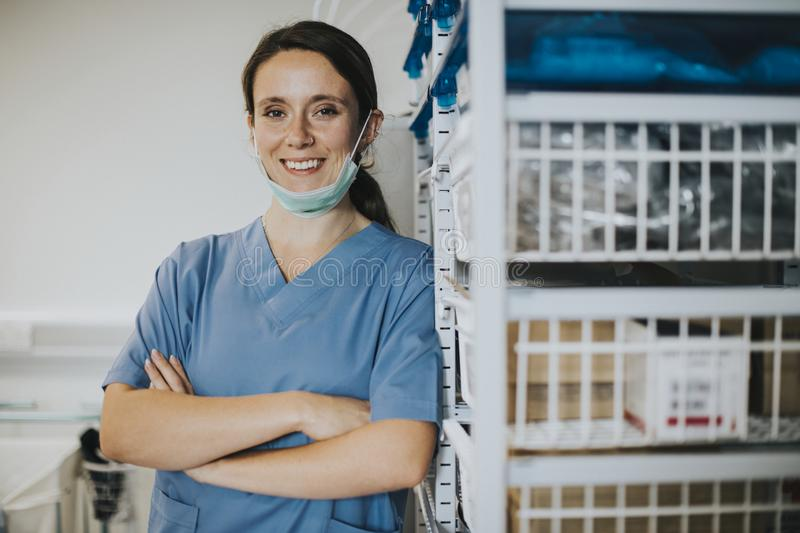 Happy nurse in a medical supplies room royalty free stock images