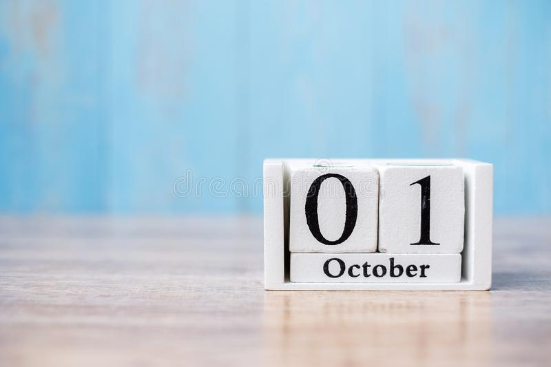 Happy October calendar wood on table, breast cancer day and Halloween concept.  royalty free stock photos