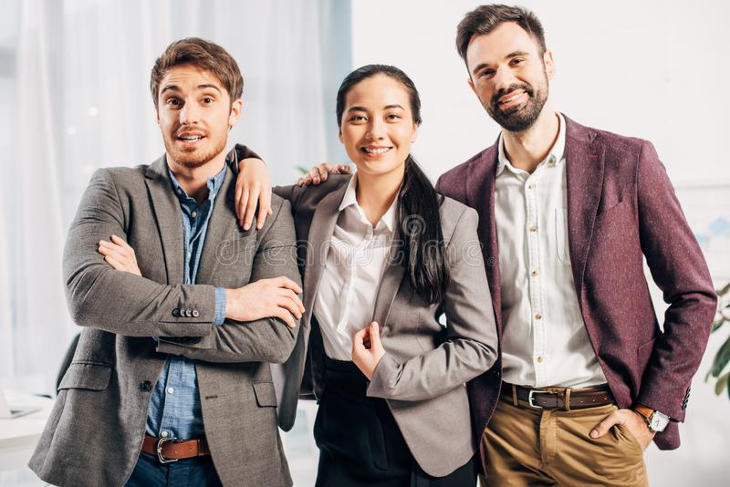 Happy office managers looking at camera and smiling royalty free stock photography