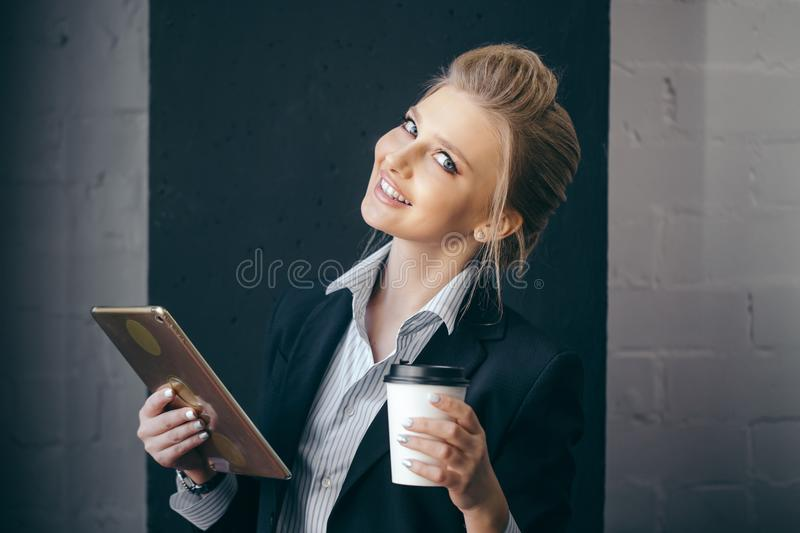 Happy office worker in the coffee break stock photos
