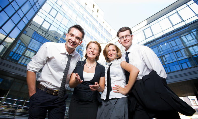 Happy office workers. Group of happy office workers stay outdoor stock images