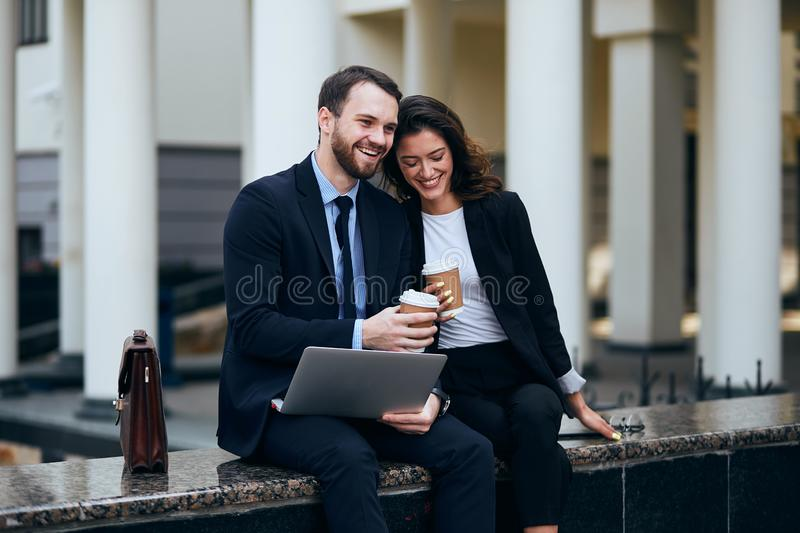 Happy office workers drink coffee and talking about work. Relax time for team meeting. happy office workers drink coffee and talking about work.favourite job stock images