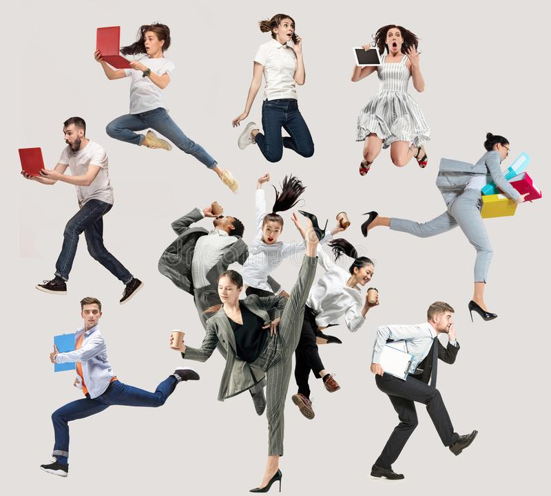 Office workers or ballet dancers jumping on white background stock photos