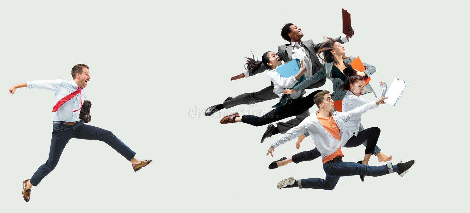 Office worker s or ballet dancers jumping on white background royalty free stock photo